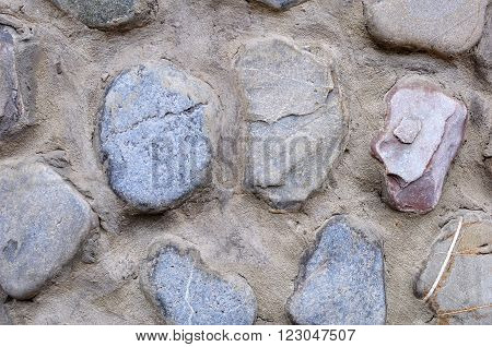 Wall of Rough Stones and Concrete Mortar Texture