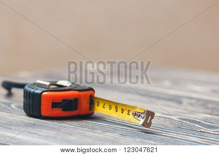 Measure tape. Home measure tape. Tape meter. wooden background