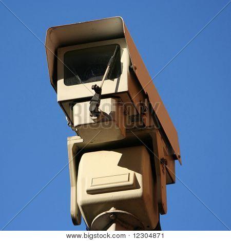close up of CCTV camera against blue sky