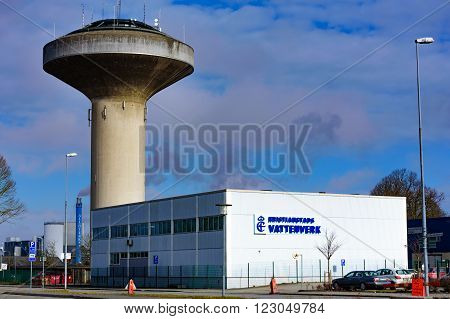 Kristianstad Sweden - March 20 2016: The water tower and the Kristianstads Vattenverk water supply building in early spring.