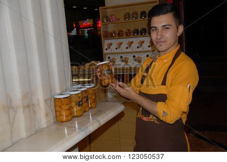 ANKARA/TURKEY-OCTOBER 30, 2014:Candied chestnut seller at the dessert shop. Candied Chestnuts are a Classic Turkish Confection. October 30, 2014-Ankara/Turkey