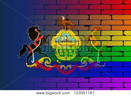 A well worn wall painted with a LGBT rainbow with the Pennsylvania state flag