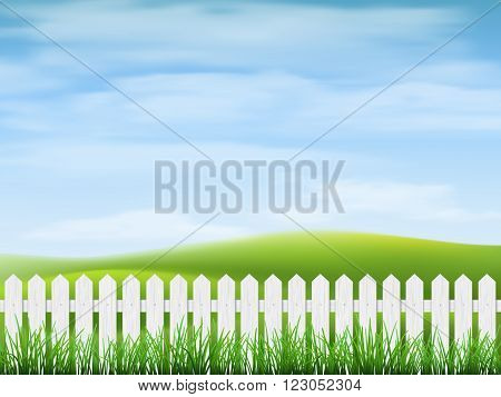 Rural landscape with sky hills grass and fence on foreground.