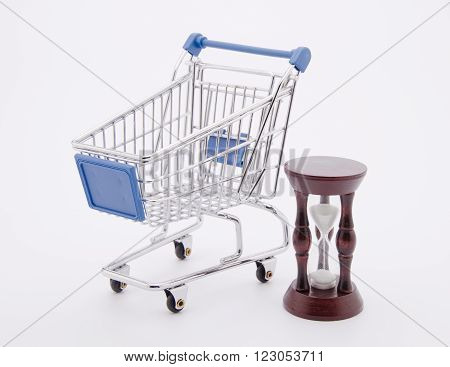 Time for Shopping (a shopping cart and an hour-glass isolated on white)