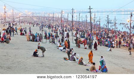ALLAHABAD, INDIA - FEBRUARY 10, 2013: Hindu devotees come to confluence of the Ganges and Yamuna River for ritual holy bathing during the festival Kumbh Mela. The world's largest religious gathering