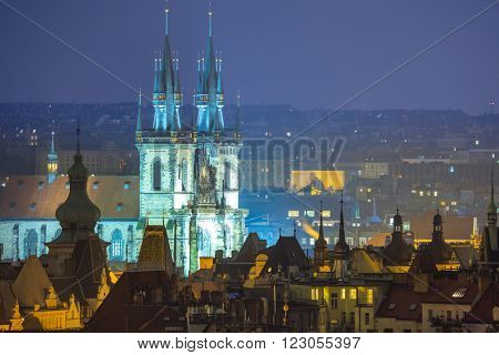 Prague, fantastic old town roofs during twilight with towers and night illumination, Czech Republic, European famous landmark