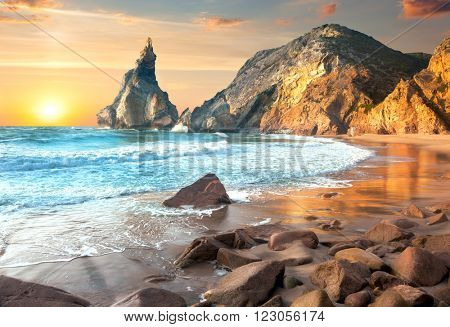 Sea Landscape at Sundown time, beautiful rocks and stones beach. Portugal, Europe