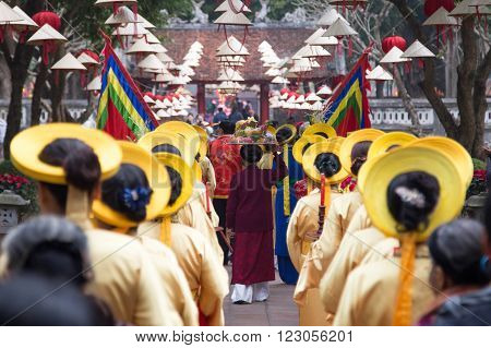 Asian civilian artists performing spiritual activities to express the respect to Buddhist and ancestor within a festival to welcome lunar new year at Temple of Literature in Hanoi capital, Vietnam.