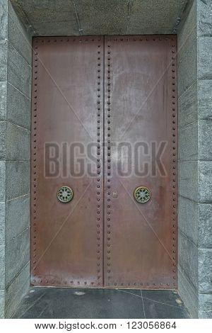 LOVCEN, MONTENEGRO - AUGUST 11, 2015: Njegos mausoleum entrance door, is a work of art by famous sculptor Ivan Mestrovic.