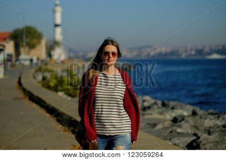 Young caucasian girl walks on coast the Sea of Marmara
