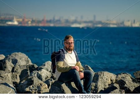 Young caucasian men walks on the coast the Sea of Marmara in Istanbul.