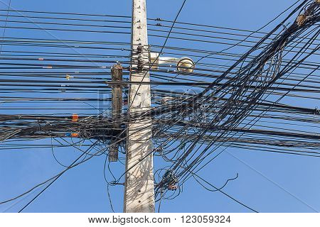 Electricity pole and complicated wiring on the pole in Thailand.