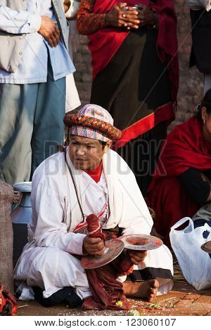 BHAKTAPUR NEPAL - APRIL 19 2013: Unknown nepali musician plays bigl karatalas during the performance of a ritual dance in celebration of Nepali New Year.
