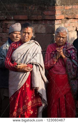 BHAKTAPUR NEPAL - APRIL 19 2013:Residents of Bhaktapur watch a ritual dance called Bhairav Dance in Bisket Jatra is which is held during the celebration of Nepali New Year on the square in Bhaktapur.