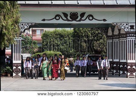 Katmandu, Nepal -  April 18 2013: Nepali  Schoolchild And Young Teachers Leave School.