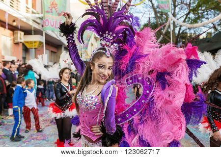 LOULE, PORTUGAL  February 2016: Cheerful carnival Carnaval parade in the city of Loule, Algarve, Portugal. Participants cheer people.