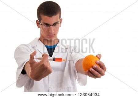Toxin Injection In Orange With Syringe. Genetically Modified Food (gmo)