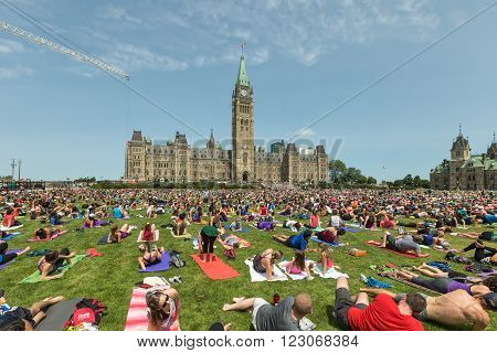 June 14, 2015, Ottawa, Canada - Yoga participants on Canada's Parliament Hill