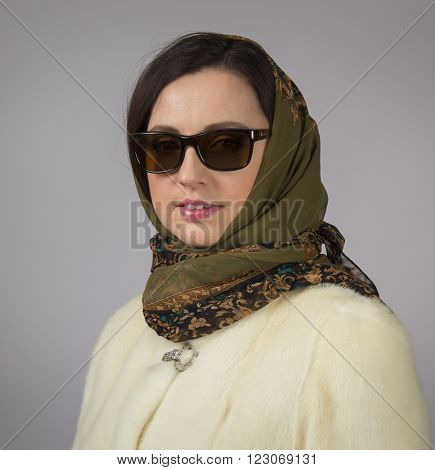 Portrait of glamor woman in glasses and headscarf