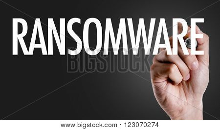 Hand writing the text: Ransomware