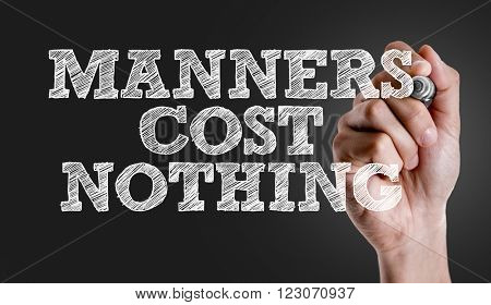 Hand writing the text: Manners Cost Nothing