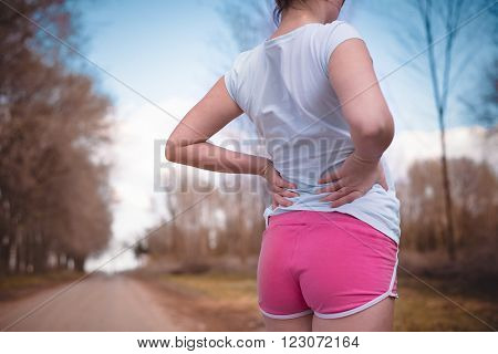 Side stitch - woman runner side cramps after running.