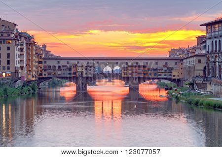 The old medieval bridge Ponte Vecchio in Florence at sunset.