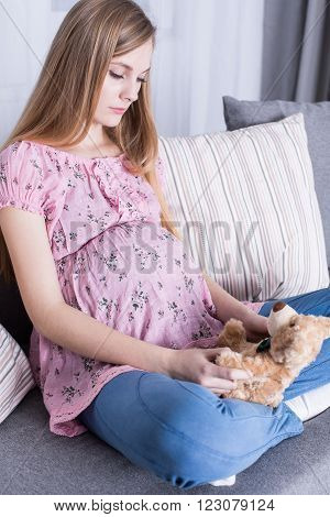 Pregnant Girl Waiting In Anticipation For Childbirth