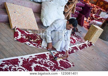Riyadh,  Saudi Arabia - November 29, 2008: A young local craftman in the Al Thumairi souq in Al Bathaa district
