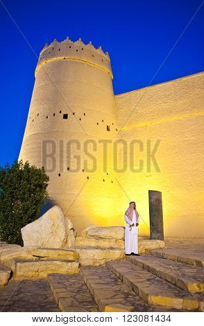 Riyadh, Saudi Arabia - November 29, 2008: A local man in front of the Masmak Fortress (XIX century) in the old city center.