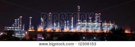 panoramic view of oil refinery plant at night