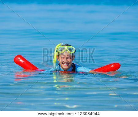 Joyful girl in mask reding scuba dive.