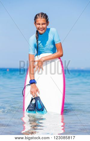 Beautiful girl with surf board reading surfing