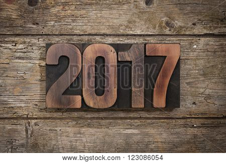 2017, year set with vintage letterpress printing blocks on rustic wooden background