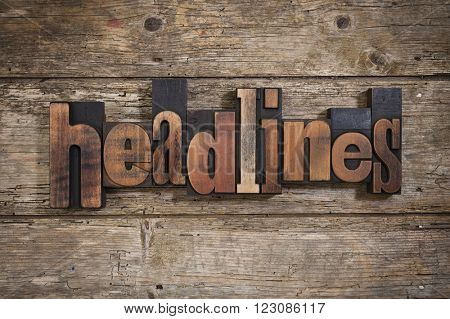 headlines, single word set with vintage letterpress printing blocks on rustic wooden background