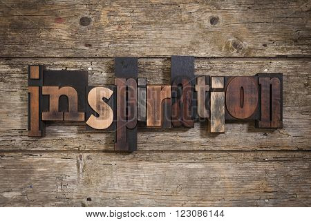 inspiration, single word set with vintage letterpress printing blocks on rustic wooden background