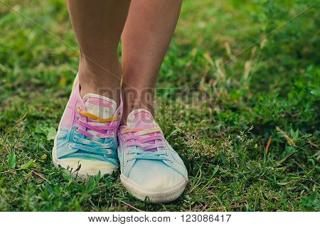 woman legs in running boots.  active lady on the grass