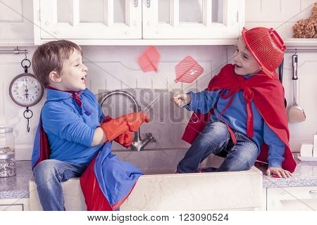 children playing at being wonderful hero in the kitchen