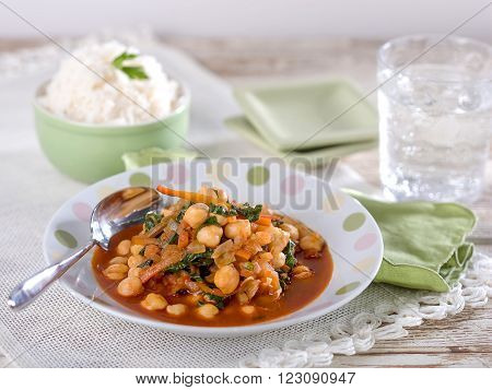 Garbanzo bean chickpea soup, a typical dish from Peru served in light colored bowl on white place mat. ** Note: Shallow depth of field
