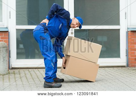 Delivery Man Suffering From Backpain