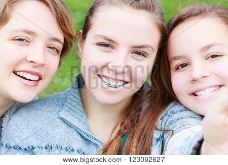 Three Cute Girls Taking a Selfie together