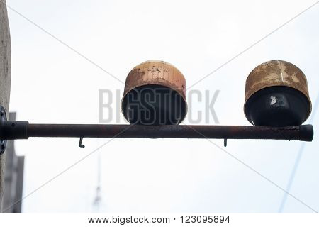 Street warning light rusted on white sky background