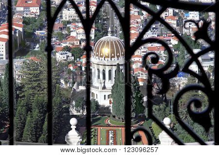 HAIFA ISRAEL - MARCH 01 2016: Look at the Bahai Temple through the fence of the upper terrace