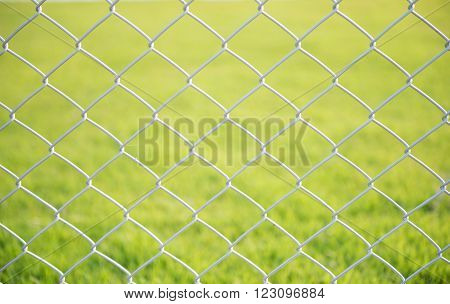 wire mesh steel with green grass background
