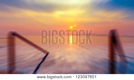 Zoom and Motion blurred background of refraction in water. Panoramic dramatic view of Infinity Swimming pool with stair and beautiful sunset on the sea at twilight times - Vintage Filter