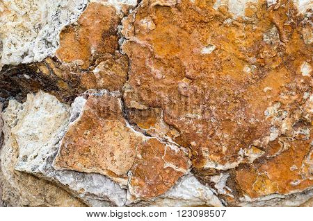 Rock texture brown and white.  Hard rock surface