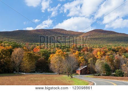 Fall foliage in upstate New York, Hudson Valley. Winding country road through the Catskill mountains.