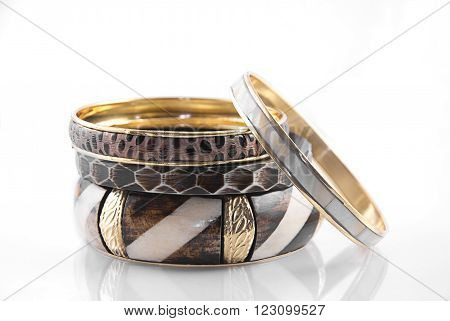 A stack of four bangles on a white background.