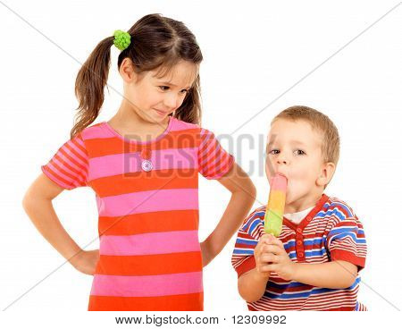 Little children sharing the ice cream