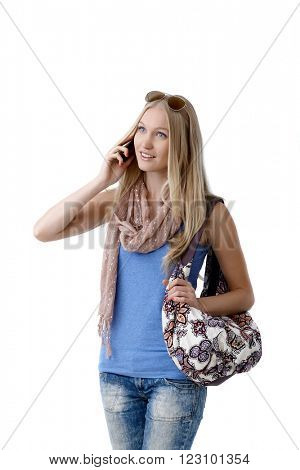 Young blonde woman talking on mobilephone at summertime.